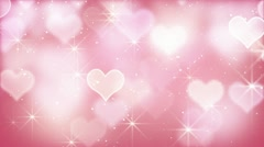 Pink bokeh hearts and particles loop Stock Footage