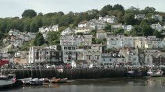 harbour and quay wall with houses on the hillside, looe, cornwall - stock footage