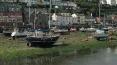 Boats and yachts sitting on dry land at low tide, looe, cornwall Stock Footage
