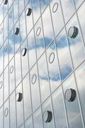 architecture with sky and cloud reflection - stock photo