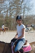 Young woman equestrian training Stock Photos