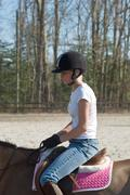 Stock Photo of young woman equestrian training