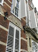 shutters of an old 17th century building in the netherlands - stock photo