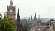 Stock Video Footage of Edinburgh Princes Street, the Balmoral Hotel and Scotts Monument.