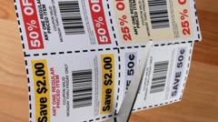 Clipping savings coupons - stock footage