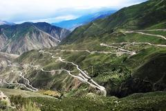 landscape of zigzag roads in the mountains - stock photo