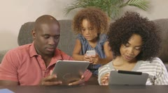African American family using cellphone and tablets - stock footage