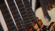 Stock Video Footage of Acoustic Guitars in Row