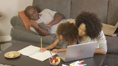 African American family doing homework with laptop - stock footage