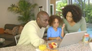 Stock Video Footage of African American family  using laptop