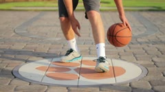Young Athlete Dribbling Basketball with Extreme Precision - stock footage