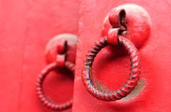 red door with iron doorknobs - stock photo