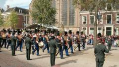 Soldiers marching with music in Holland Stock Footage