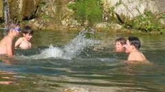 Boys playing in water Stock Footage