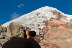 Stock Photo of Mountain Tracker Studying The Peak Of Chimborazo Volcano For Avalanches With A