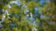 Water splashing over blurred backgorund Stock Footage