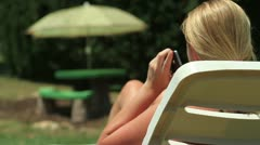 Woman Answers Phone Outside Stock Footage