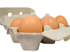 half dozen fresh eggs in box - stock photo