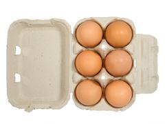 half dozen fresh eggs in box - stock photo