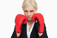 Combative woman with red gloves fighting - stock photo