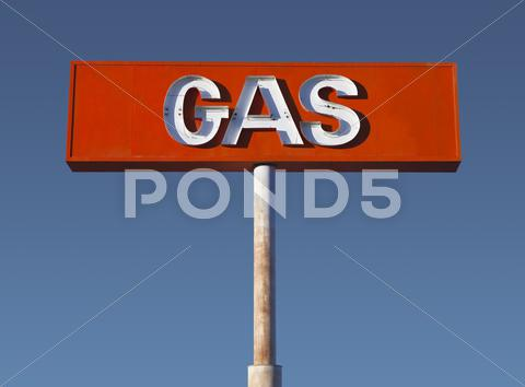 Stock photo of vintage desert neon gas sign