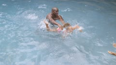 African American family in swimming pool - stock footage