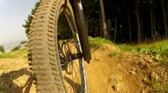 Downhill Mountain Bike Front Wheel View - stock footage