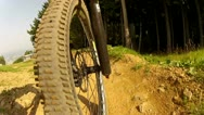 Stock Video Footage of Downhill Mountain Bike Front Wheel View