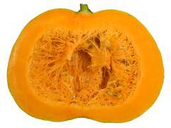round orange pumpkin cut in half - stock photo
