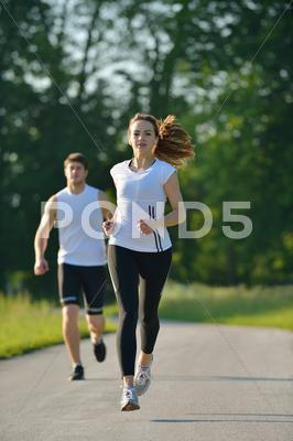 Stock photo of young couple jogging at morning
