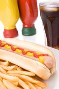 fast food meal with hotdog, french fries and a cola. - stock photo