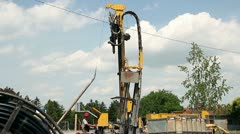 Workers Operate a Drilling Rig for a Natural-Gas Stock Footage