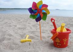 Toys on a beach Stock Photos