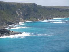 Cliffs and blue sea Stock Photos