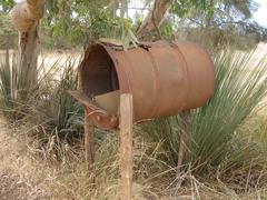 Rusty mail box in Australian outback - stock photo