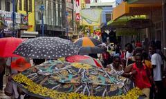umbrellas in bridgetown, on a rainy day - stock photo