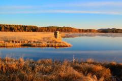 Sunrise landscape of lake in grassland Stock Photos