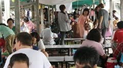 Busy restaurant in Bangkok Thailand open air Stock Footage