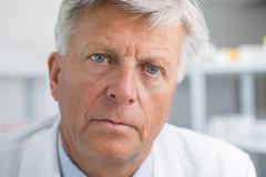 Earnest looking doctor - stock photo