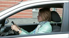 Female fastening a seat belt in vehicle Stock Footage