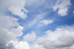 White bold clouds over a blue sunny sky - stock photo