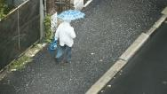Old man walking on the rain Stock Footage