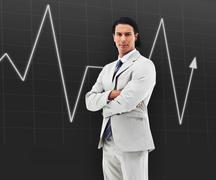 Man with arms crossed standing in front of a statistic - stock photo