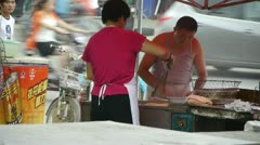 Roadside snack bar cooking,China town fairs market,selling fritters,crowded str Stock Footage