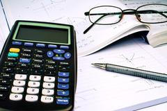Scientific Calculator with exercise books and glasses Stock Photos