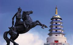 Statue of mongolian saber and a pagoda Stock Photos
