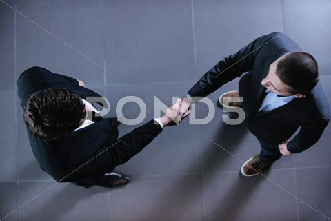 Stock photo of business people making deal