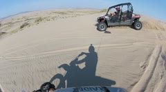 Don jumping RZR sand dunes Stock Footage