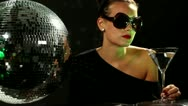 Woman dances with a discoball Stock Footage