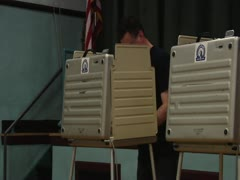 Man Votes in Voting Booth Stock Footage